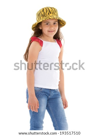 A smiling girl in a yellow hat, t-shirt and jeans - stock photo