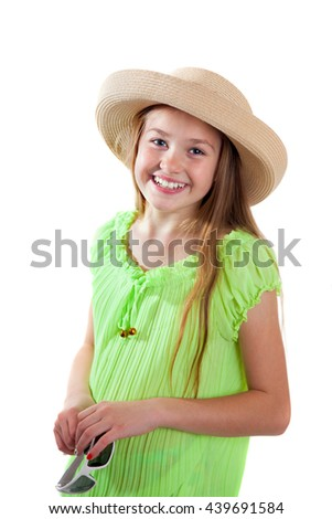 A smiling girl in the hat, isolated on white background - stock photo