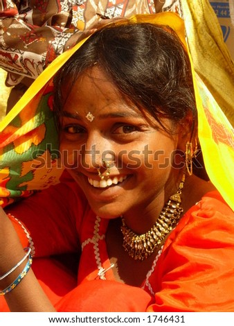 a smiling maiden in indian village - stock photo