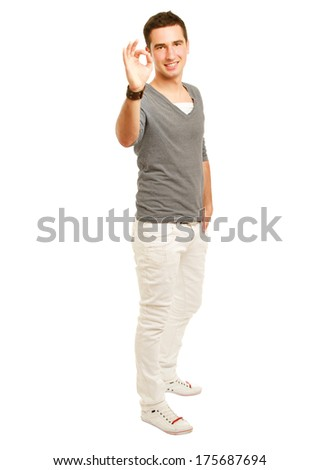 A smiling man showing thumb up sign, isolated on white background - stock photo