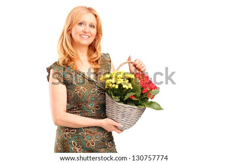 A smiling mature female holding flowers isolated on white background