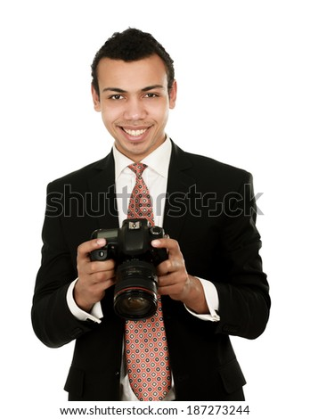 A smiling professional photographer