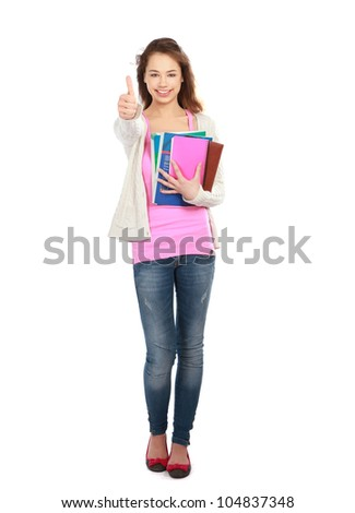 A smiling student girl with books and thumb up sign, isolated on white - stock photo