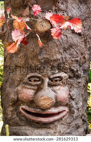 a smiling tree with a laughing face