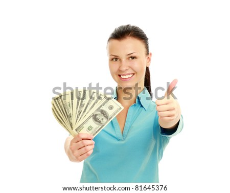 A smiling woman holding dollars with thumb up sign, isolated on white background