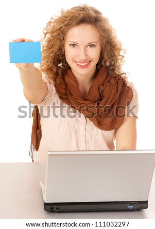 A smiling woman with a laptop and a blue small blank on white