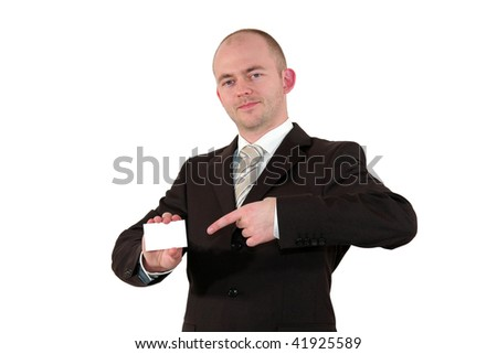 a smiling young business man pointing at a business card with copy space, isolated on white background