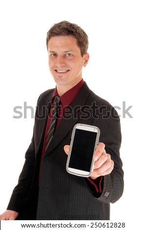 A smiling young businessman showing his new cell phone, isolated for white background.  - stock photo