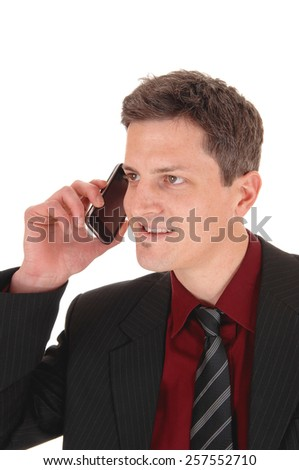 A smiling young businessman talking his cell phone, isolated for white background.  - stock photo