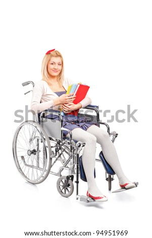 A smiling young girl in a wheelchair isolated on white background