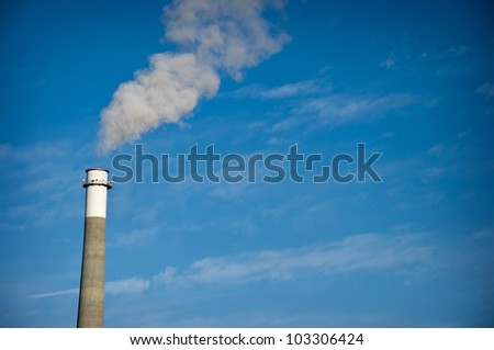 A Smoke Stack Releasing Pollution into the Air - stock photo