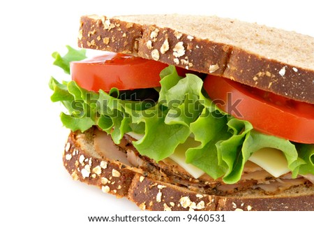 A smoked turkey sandwich on whole oat bread isolated on a white background. - stock photo