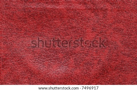 A smooth, red leather background, suitable for backgrounds - stock photo