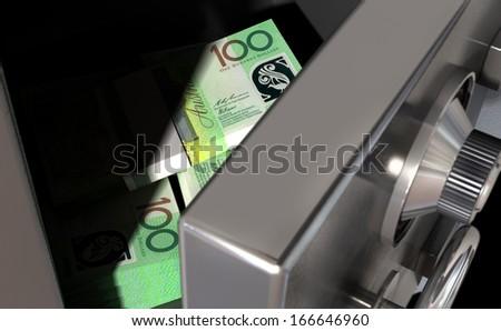 A sneak peak closeup of a slightly open metal safe revealing bundles of australian dollar notes inside of it - stock photo