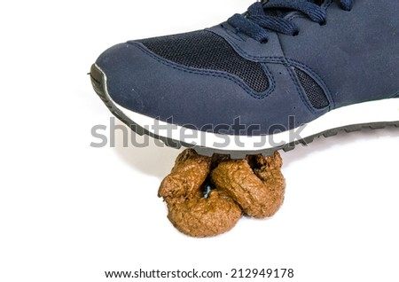 A sneaker steps onto a shit. Good luck concept. Poo
