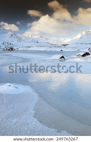 A snow and ice covered winter mountain landscape near Glencoe in the Scottish highlands