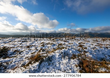 A snow covered plateau  looking out across the Derwent Fells near Keswick in the English Lake District, Cumbria, England. UK. - stock photo