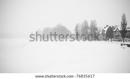 A snowy street in sweden during the winter - stock photo