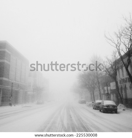 A snowy street in the middle of a blizzard. - stock photo