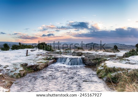 A snowy waterfall on Dartmoor National Park in Devon at Windy Post near Princetown