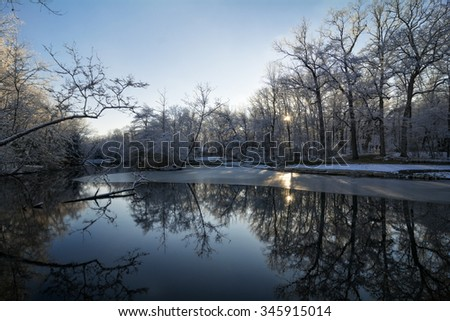A snowy winter lake scene along at Mallard Lake in Oak Openings park Northwest Ohio. - stock photo
