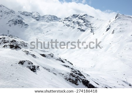 A snowy winter landscape on a ski resort in the Alps. - stock photo