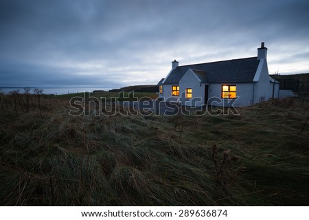 A snug croft at Clachtoll Bay on the North West Highlands of Scotland. - stock photo