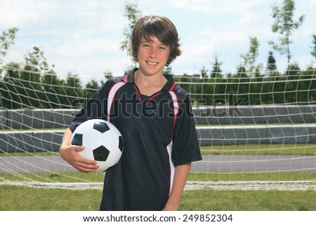 A soccer player on the play field. - stock photo