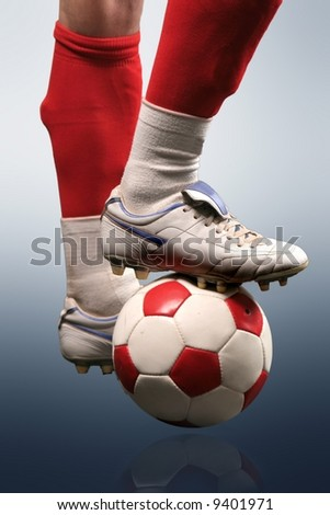 a soccer shoes and a ball - stock photo