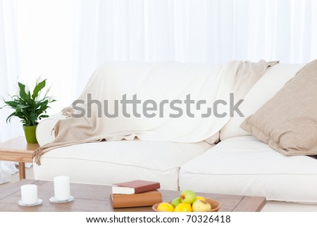 A sofa in the living room at home - stock photo