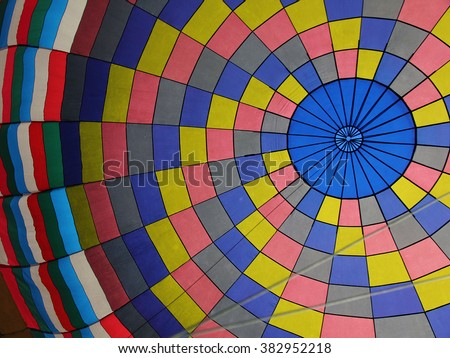 A soft focus, peaceful picture of the colorful inside of a hot air balloon. - stock photo