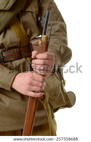 a soldier holding his rifle on the white background - stock photo