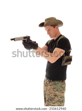 A soldier in a camouflage uniform pointing his pistol, isolated on white background.  - stock photo