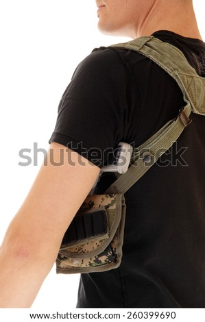 A soldier in black t-shirt with his gun in the holster, an closeup from the back, isolated on white background.  - stock photo