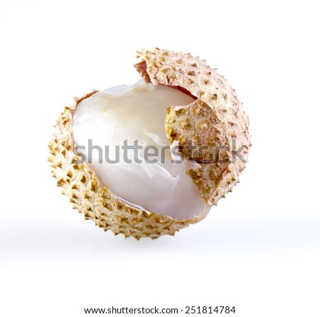 a solitair litchi against a white background