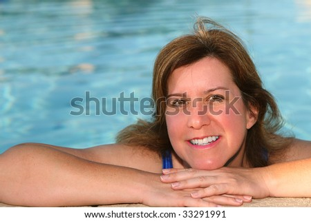 A 40 something model relaxing in the pool