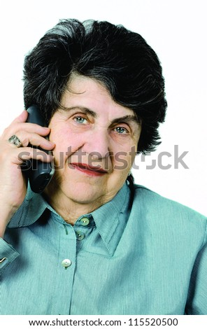 A sophisticated senior lady enjoying a cell phone conversation. - stock photo