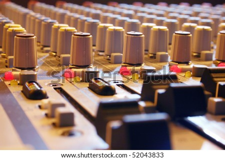 A sound control mixer detail view. - stock photo