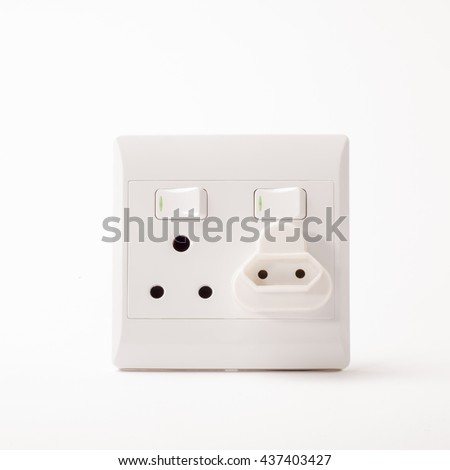 A South African Electric Double Wall Plug with an adapter for a two point plug situated on a white background.