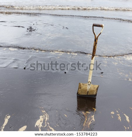 A Spade on dirty beach as tool to scoop crude oil on clean-up operation from crude oil spilled into Ao Prao Beach on July 31, 2013 in Rayong province, Thailand.