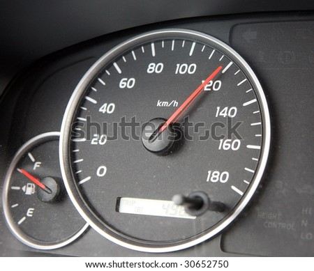 A speedometer races past hundred.