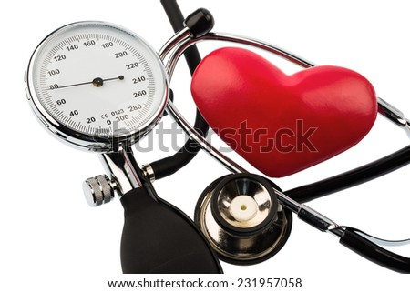 a sphygmomanometer, a heart and stethoscope lying on a white background - stock photo