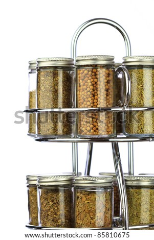 a spice rack with white isolate background, filled with fresh organic spices and herbs