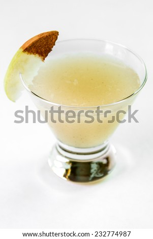 A spicy pear cocktail against a white background