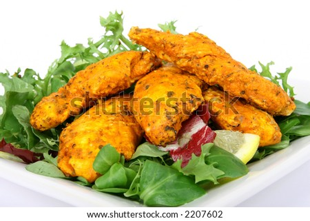 A spicy summer starter, simple lemon chicken salad macro close up isolated on white - stock photo