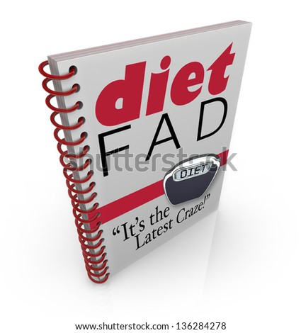 A spiral-bound book with the words Diet Fad - It's the Latest Craze to illustrate a new dieting sensation inside a best-selling manual or guide to help you lose weight - stock photo
