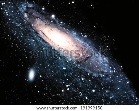 a spiral galaxy in the universe - stock photo
