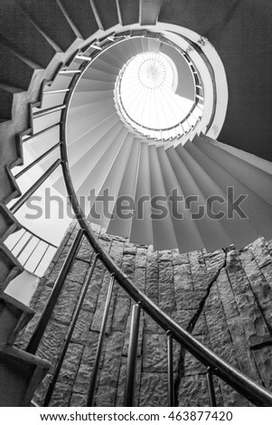 A spiral staircase to light