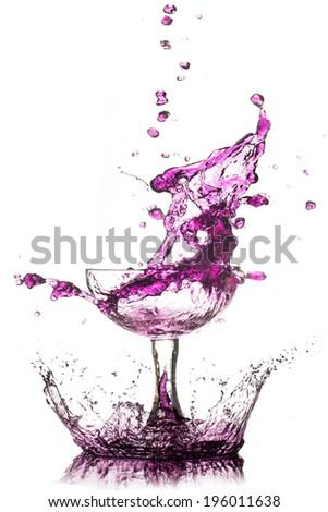 A splash of purple cocktail on white background. - stock photo