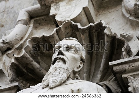 a spooky old statue of a man - stock photo